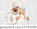 smiling couple in winter clothes hugging over snow 25791690