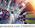 factory worker turning valve 25804033