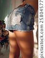 Beautiful female legs in denim shorts, close-up 25804577