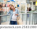 Pregnant woman touching her forehead, having 25831980