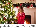 Child decorating Christmas tree 25835291