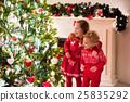 Kids under Christmas tree 25835292