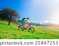 A young male riding a mountain bike downhill 25847253