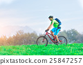 A young male riding a mountain bike outdoor 25847257