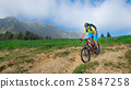 A young male riding a mountain bike outdoor 25847258