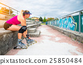 Sporty girl you change to make rollerblade on the steps of the f 25850484