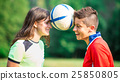 Two girl soccer players 25850805