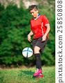 Woman footballer 25850808