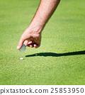 Placing golf ball 25853950