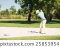 Golfer playing from sand trap 25853954