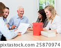 Lawyers in meeting negotiating agreement 25870974