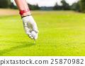 Man putting golf ball on tee, close shot 25870982