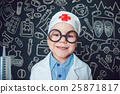 Happy little boy as a doctor in glasses holding 25871817