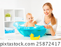 Happy family mother bathes the baby in  bath 25872417