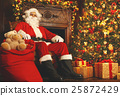 Santa Claus with gifts around Christmas tree 25872429