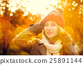 Young Woman in Beanie Hat on Autumn Background 25891144
