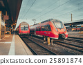 High speed red commuter trains at railway station 25891874