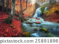 Autumn forest with waterfall at mountain river  25891896