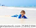 little blond kid boy having fun on tropical beach 25892394