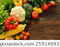 Vegetables and fruits on old wooden background 25914093