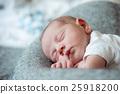 Newborn baby boy lying on bed, sleeping, close up 25918200