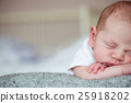 Newborn baby boy lying on bed, sleeping, close up 25918202