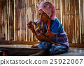 Female karen hill tribe is smoking tobacco pipe  25922067