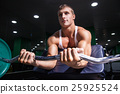 Muscular man doing exercise on biceps 25925524