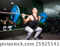 Sportsman squats in gym 25925541