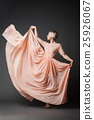 Woman dancing in chiffon dress 25926067