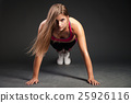 Woman making push-ups 25926116