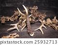 Deer Antlers On Wooden Background 25932713