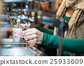 Girl at the bar prepares espresso coffee 25933609