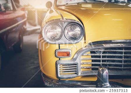 Close up headlight of yellow Retro classic car 25937313