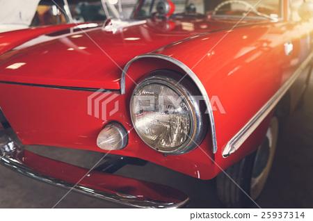 Close up headlight of red Retro classic car 25937314