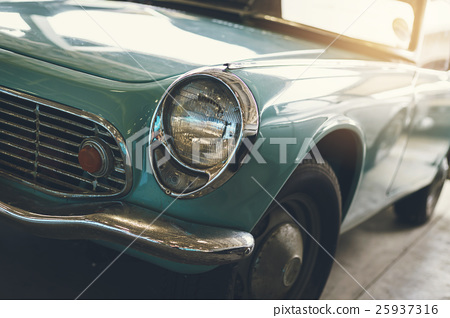 Close up of headlight Retro classic car 25937316