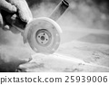 Grinder worker cuts a stone 25939006
