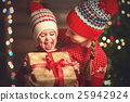 Happy family mother and child girl  with Christmas present 25942924