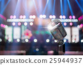 Retro microphone over the Stage Spotlight with blue luminous rays and Blurred Photo bokeh from light,musical concert and instrument concept 25944937
