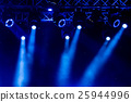 blue luminous rays from concert lighting against a dark background, musical instrument concept 25944996