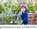 beautiful smiling little boy holding christmas 25962505