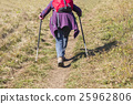 Older woman walking by hiking trail 25962806