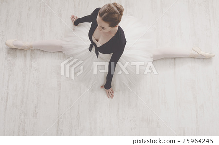 Stock Photo: Classical Ballet dancer in split portrait, top