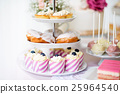 Tarts, crem puffs, cupcakes on cakestand. Cake 25964540
