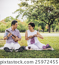 Senior Adult Couple Knitting Park Relaxation Concept 25972455