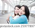 asia cheerful hug 25977897