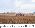Red Tractor Plowing in Autumn 25980020