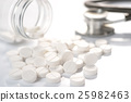 White round medicine tablets and stethoscope  25982463