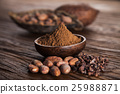 Cocoa beans in the dry cocoa pod fruit on wooden 25988871