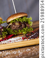 Home made hamburge, wooden desk background. 25988954